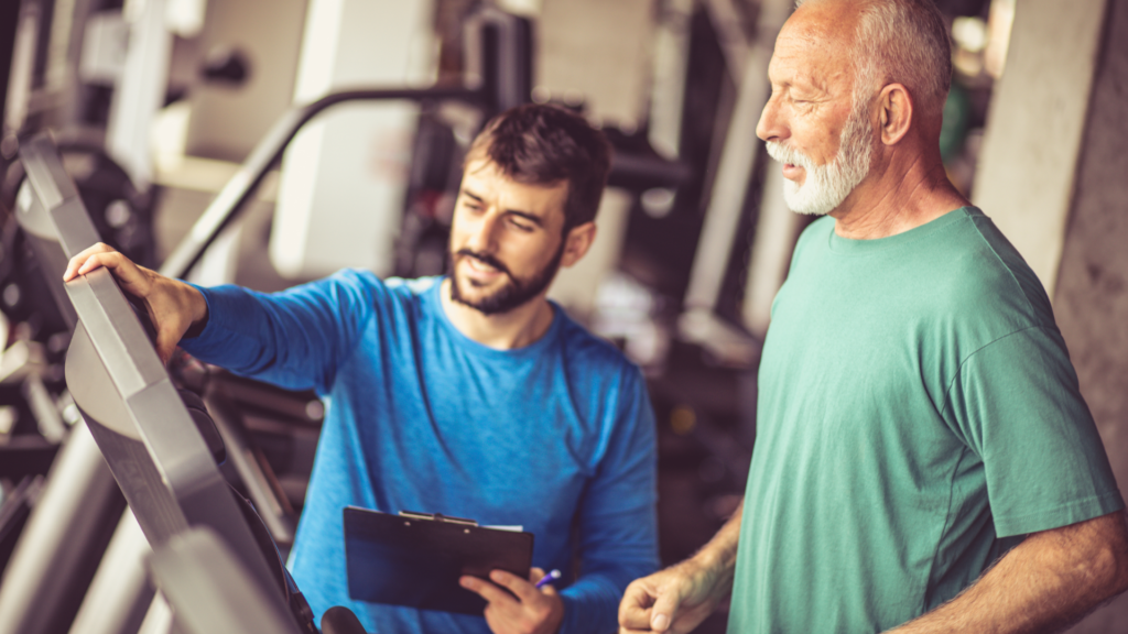 Older white male exercises on treadmill to get rid of headaches with PT supervision